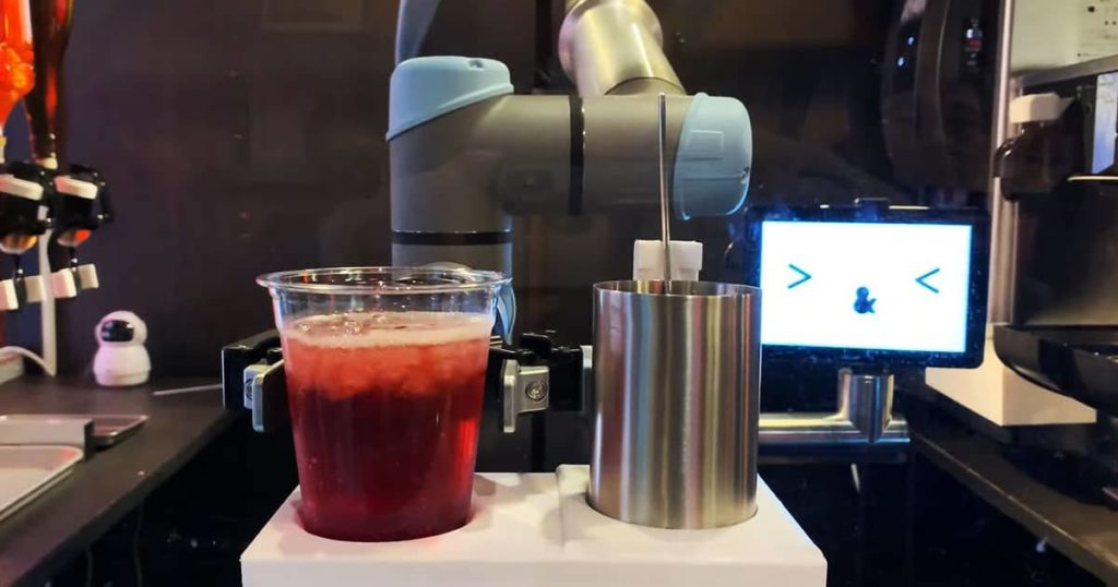 robot bartender serves drinks at japanese pub 1
