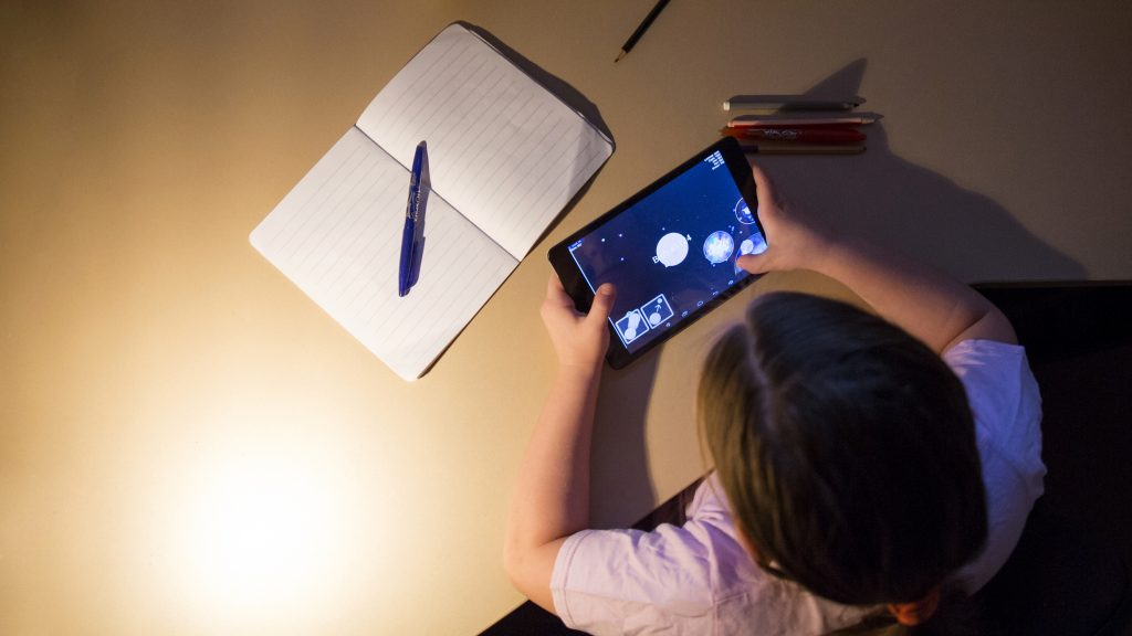 Kid playing on a Tablet